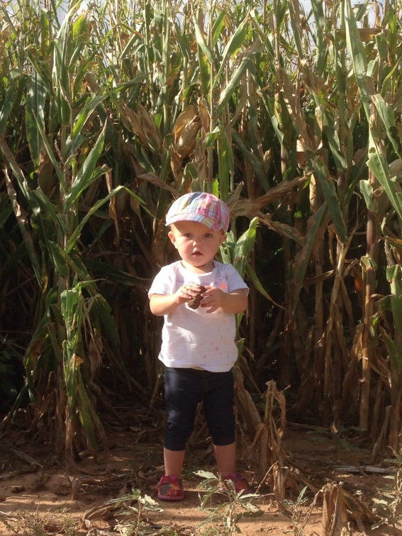 Claire standing by corn
