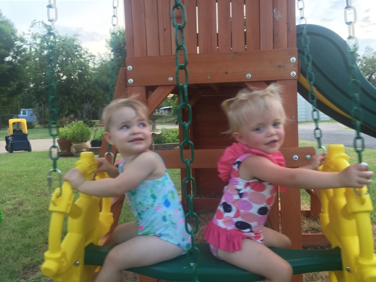 Greer and Claire swinging